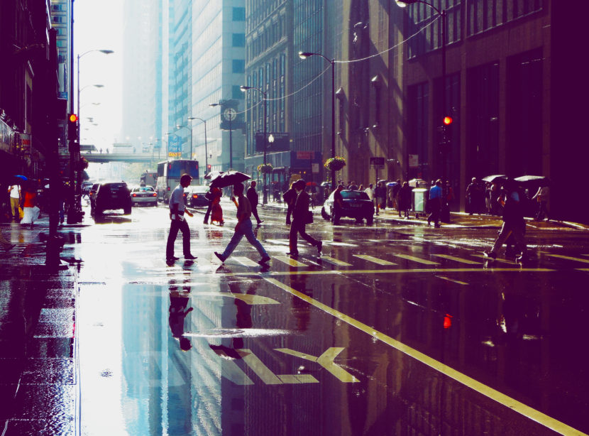 chicago-skyscrapers-buildings-people-street-puddle-reflection